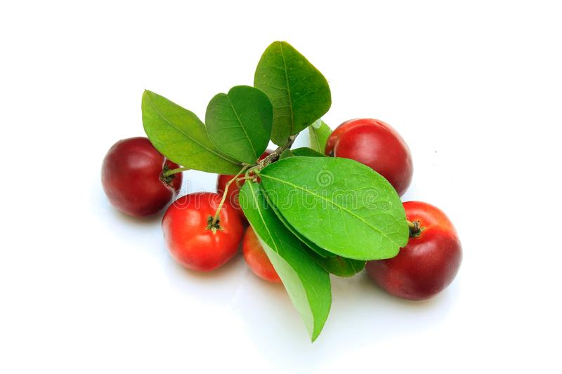 Group of fresh organic acerola with green leaves, isolated on white background with clipping path stock photo