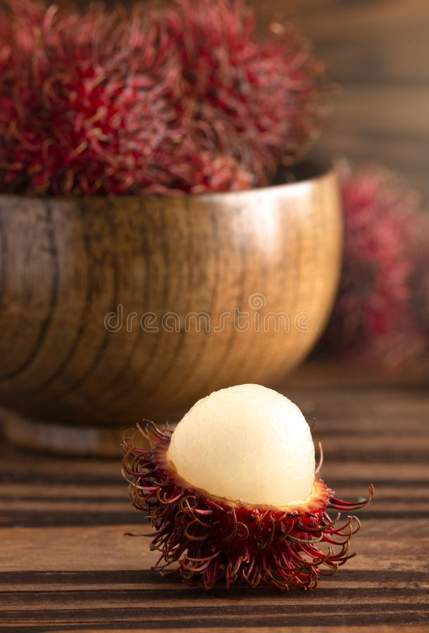Group of Fresh Red Rambutan on a Wooden Table stock images