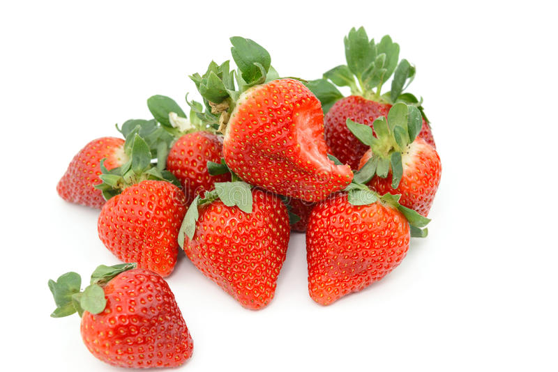 Group of fresh Strawberry on white background. Fresh Strawberries on white background. Piling up and arranging in order stock image