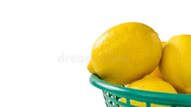Group of fresh yellow lemons in green basket isolated picture on white background royalty free stock photos