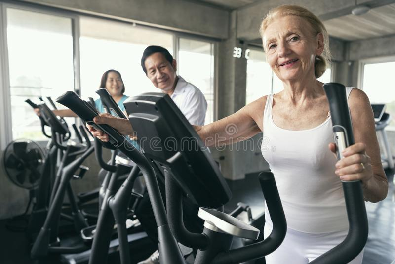 Group friend of senior runner at gym fitness smiling and happy. stock photography