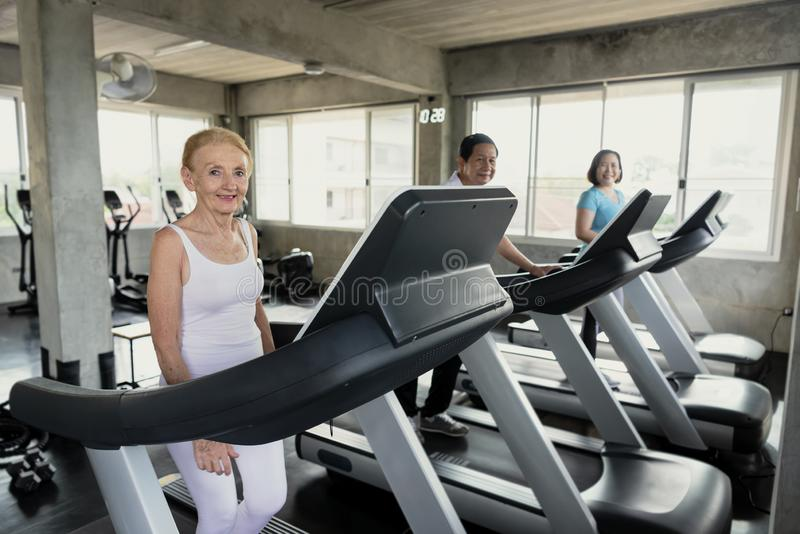 Group friend of senior runner at gym fitness smiling and happy. elderly healthy lifestyle royalty free stock image