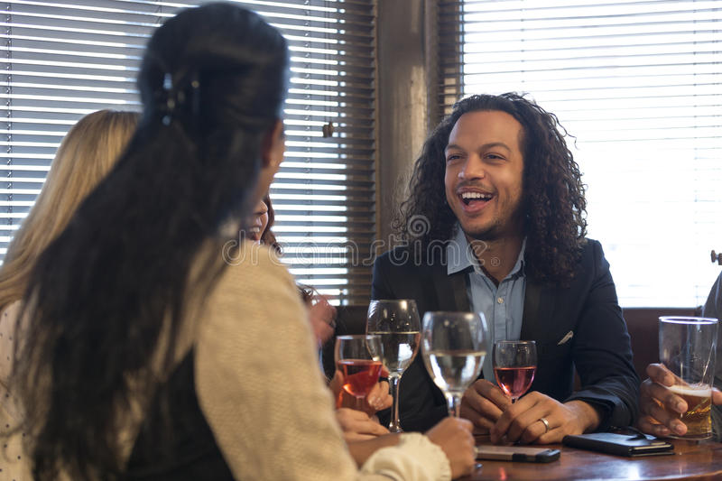 Group of friends in a bar royalty free stock images
