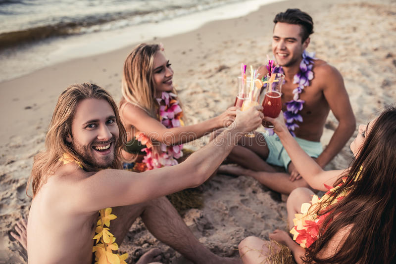 Group of friends on beach stock photo