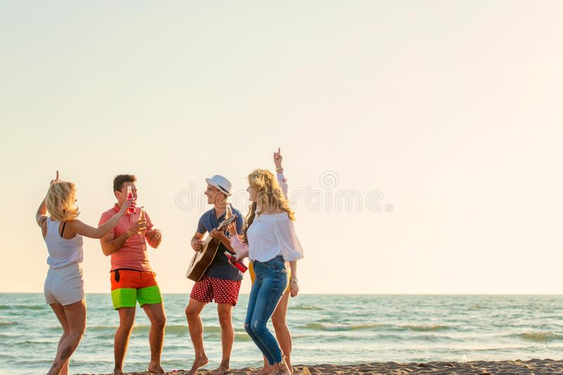 Group of friends play on the beach stock images