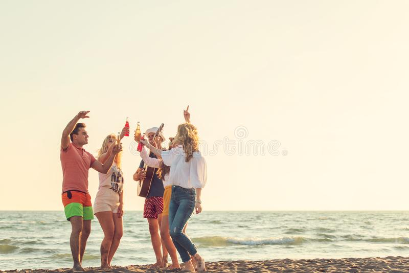 Group of friends play on the beach royalty free stock images