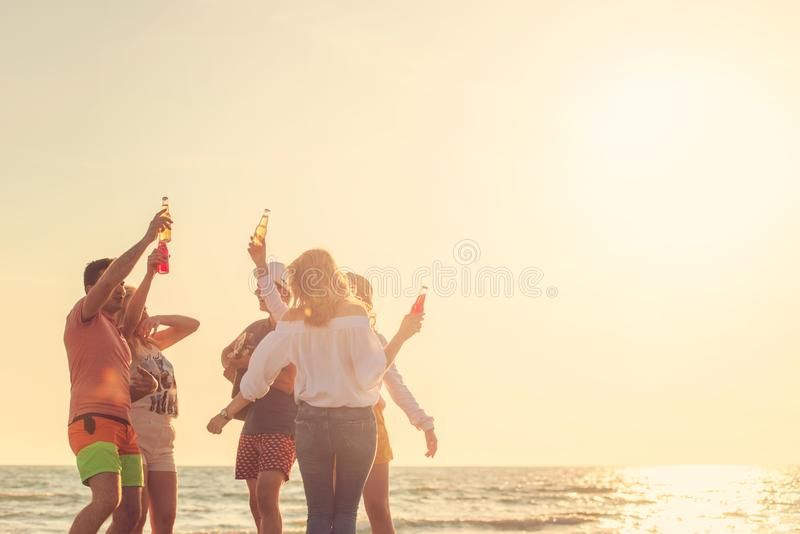 Group of friends play on the beach stock image