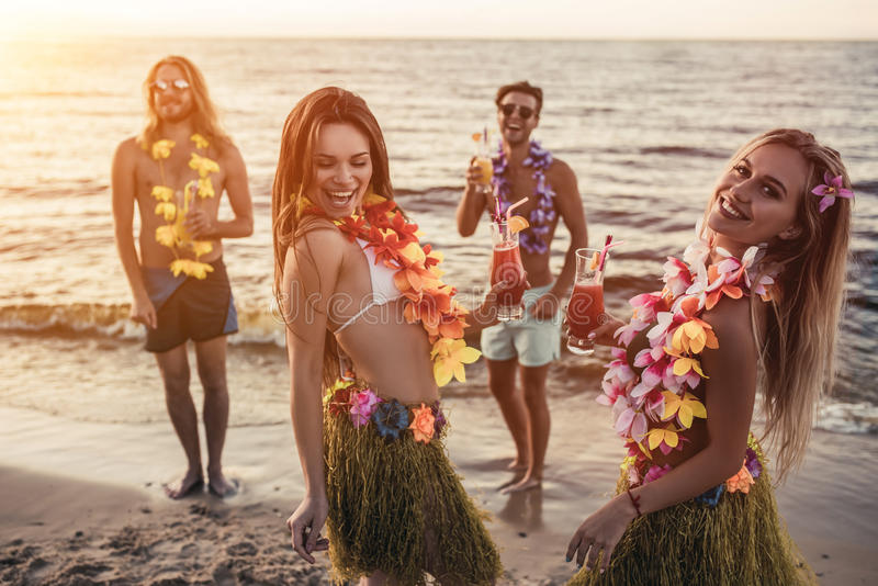 Group of friends on beach royalty free stock image