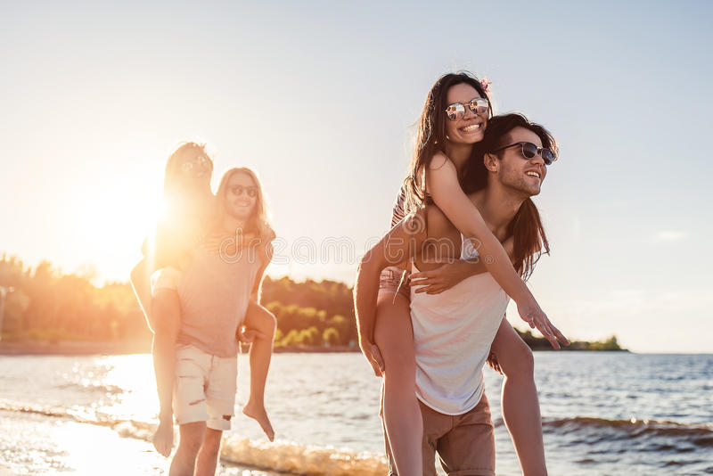 Group of friends on beach royalty free stock images