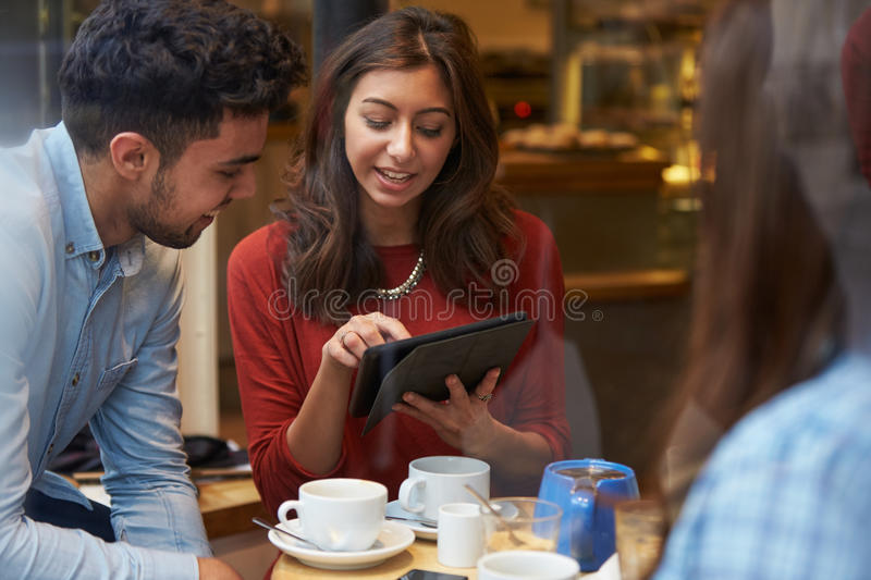 Group Of Friends In Caf� Using Digital Tablet stock images