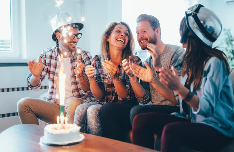 Group of happy friends celebrating birthday at home together. Group of friends celebrating birthday at home together royalty free stock photography