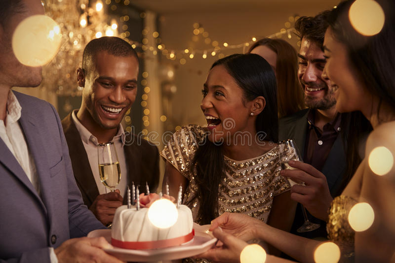 Download Group Of Friends Celebrating Birthday With Party At Home Stock Photo - Image: 91321016