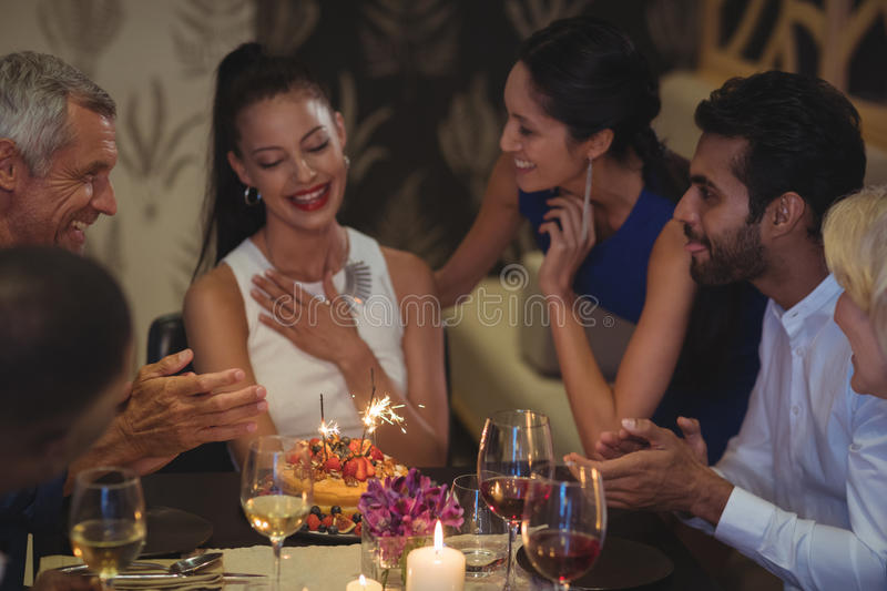 Group of friends celebrating birthday royalty free stock images