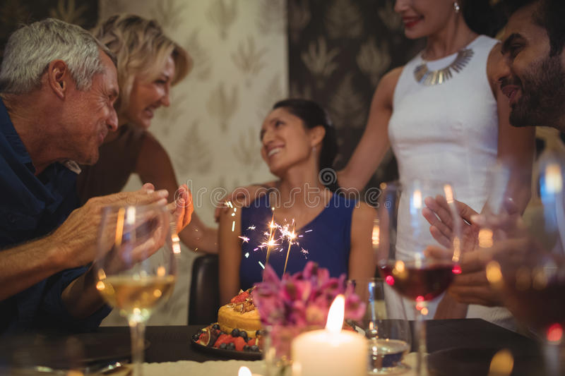 Group of friends celebrating birthday royalty free stock image