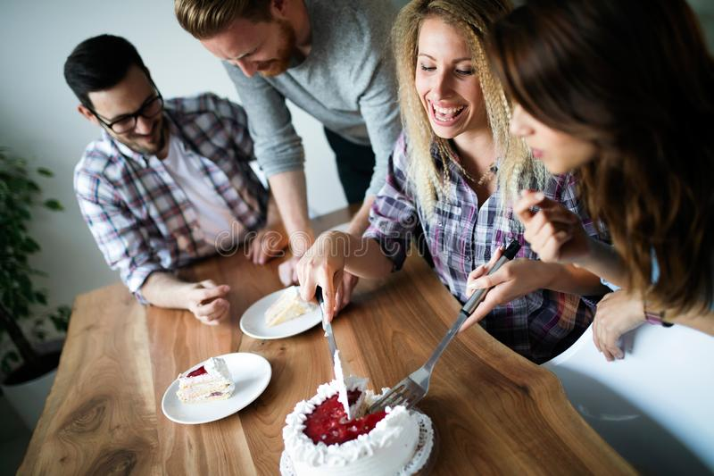 Group of friends celebrating birthday together at home. Group of happy friends celebrating birthday together at home royalty free stock photography