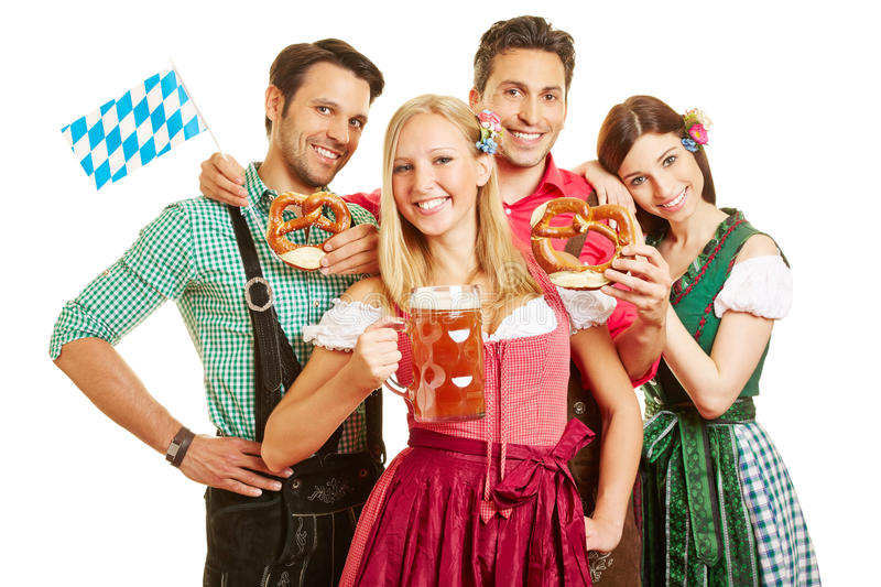 Group of friends celebrating. Happy group of friends celebrating Oktoberfest with beer and pretzel royalty free stock photo