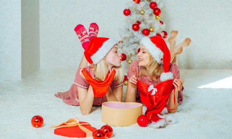 Group of friends celebrating new year and merry Christmas. Funny girls and friendship concept. Christmas wishes come stock photography
