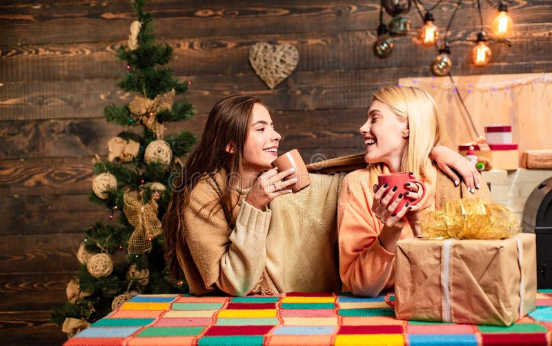 Group of friends celebrating new year and merry Christmas. hristmas hot mulled wine. Funny girls and friendship concept royalty free stock photography