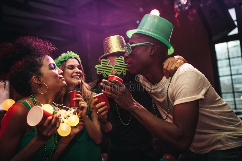 Group of friends celebrating St. Patrick`s Day at bar royalty free stock photos
