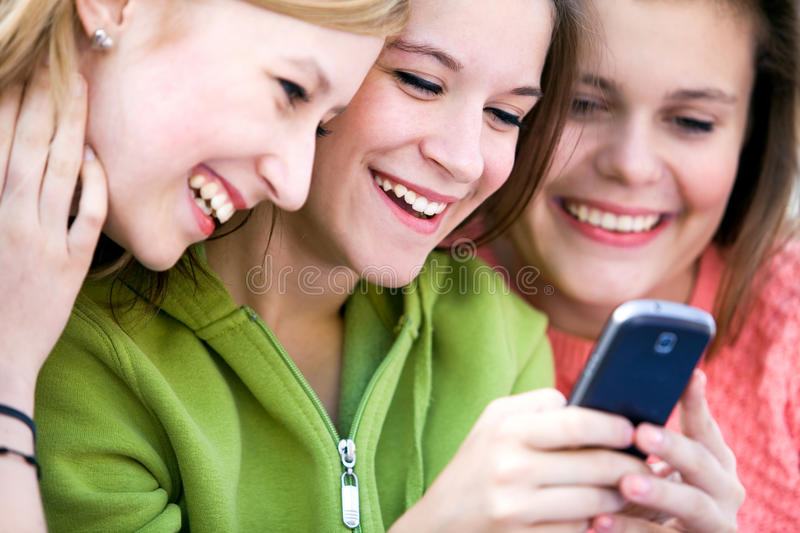 Group of friends with cellphone stock photo