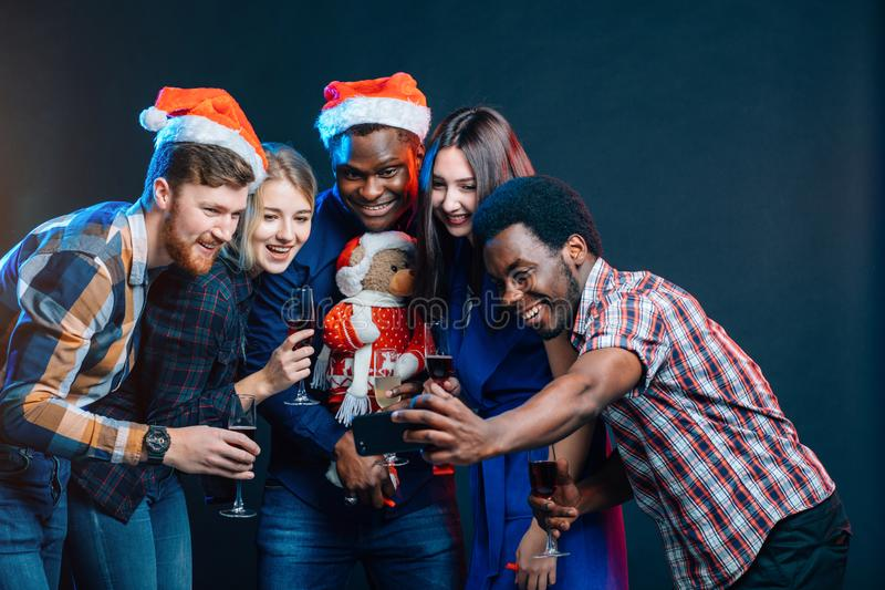 Friends at club making selfie and having fun. Christmas and New year concept royalty free stock photo