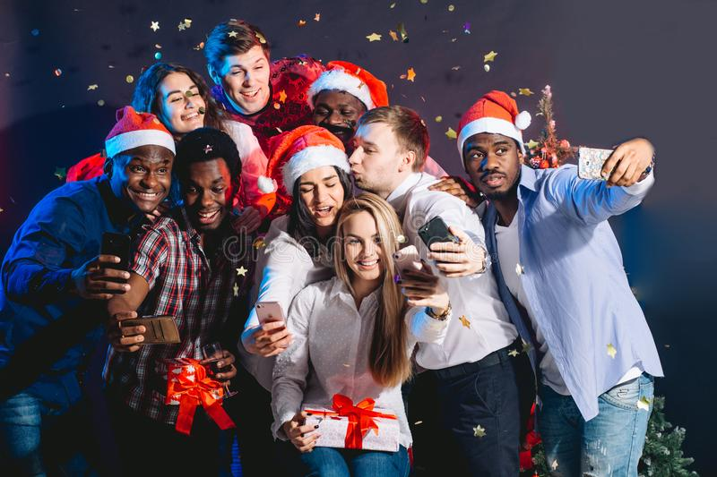 Friends at club making selfie and having fun. Christmas and New year concept royalty free stock photos