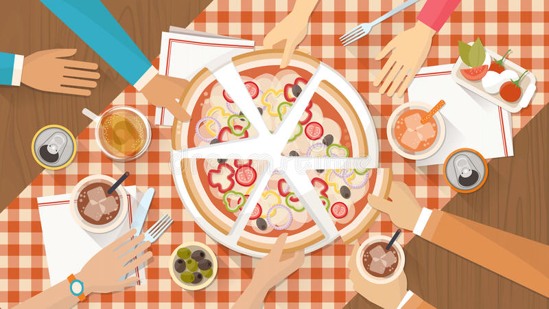 Group of friends eating pizza together. People having dinner together and sharing a huge pizza with drinks, hands top view