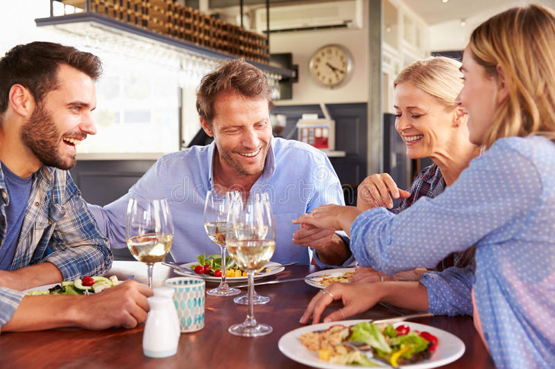 A group of friends eating at a restaurant stock photography