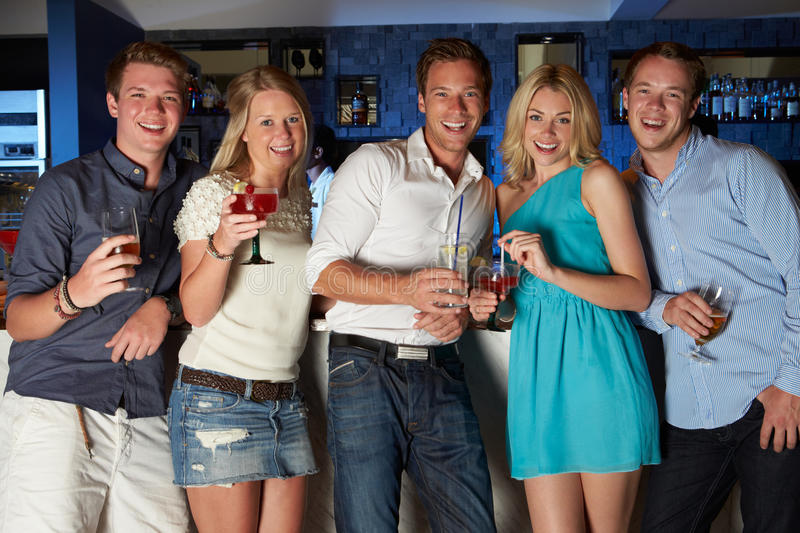 Group Of Friends Enjoying Drink In Bar stock photography