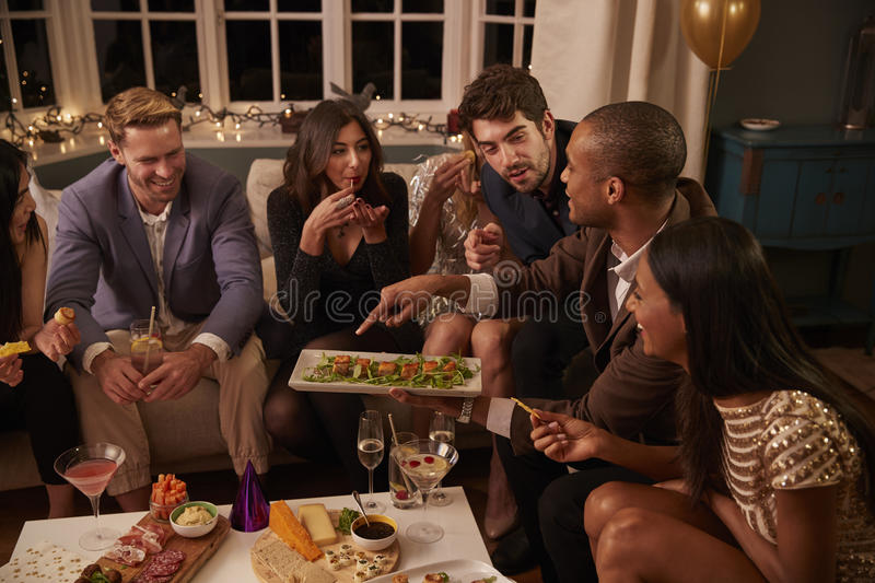 Download Group Of Friends Enjoying Drinks And Snacks At Party Stock Image - Image: 91320969