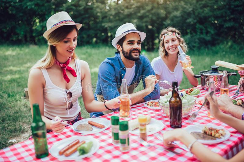 Friends enjoying a lunch time together in the nature stock images