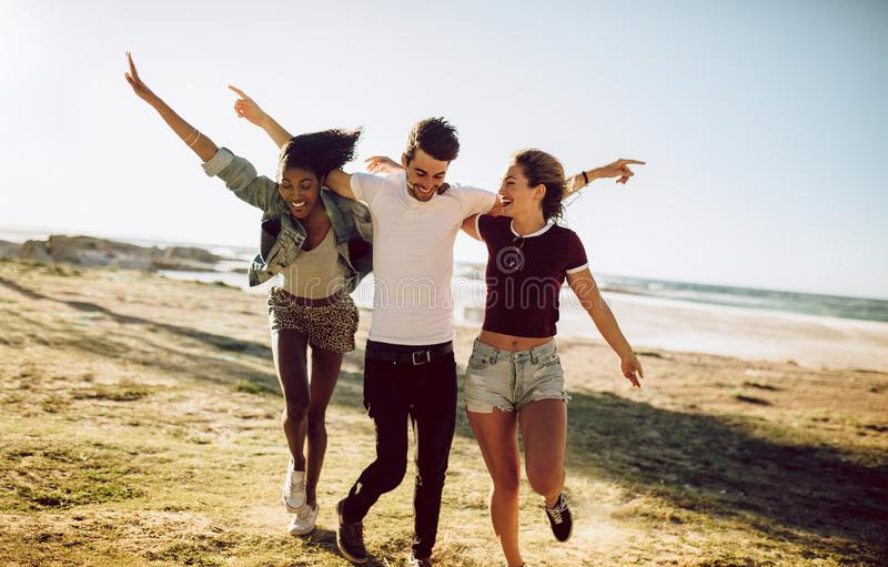 Group of friends enjoying themselves outdoors royalty free stock photography