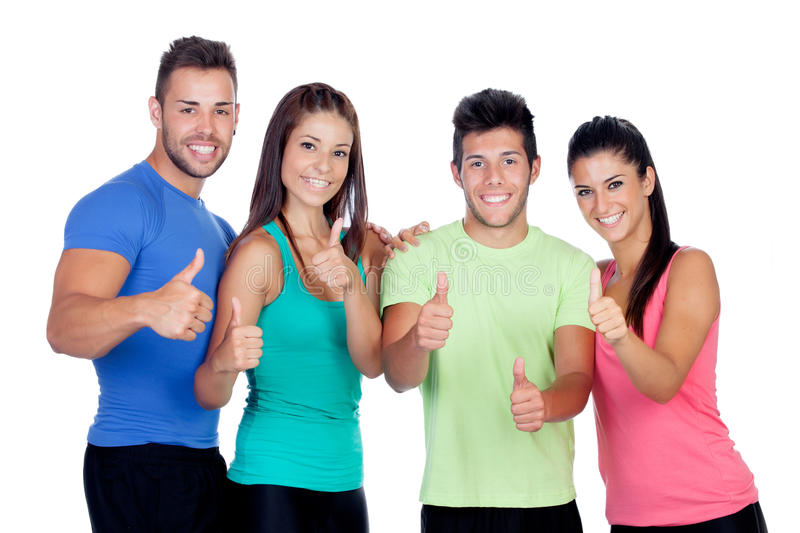 Group of friends with fitness clothes saying Ok. Isolated on a white background stock image