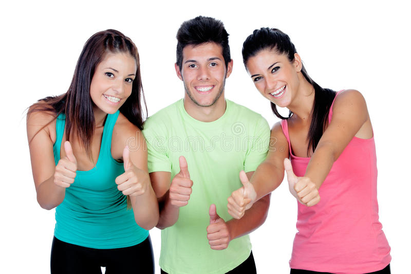Group of friends with fitness clothes saying Ok. Isolated on a white background stock images