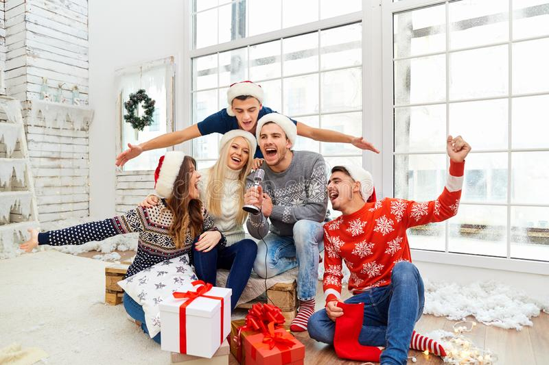 A group of friends with gifts at a Christmas party stock photos