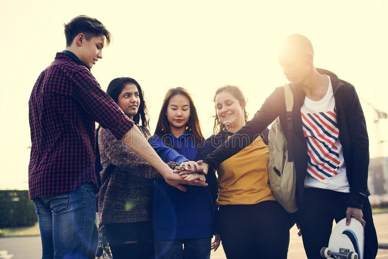 Group of friends hands stacked together support and teamwork concept royalty free stock photo