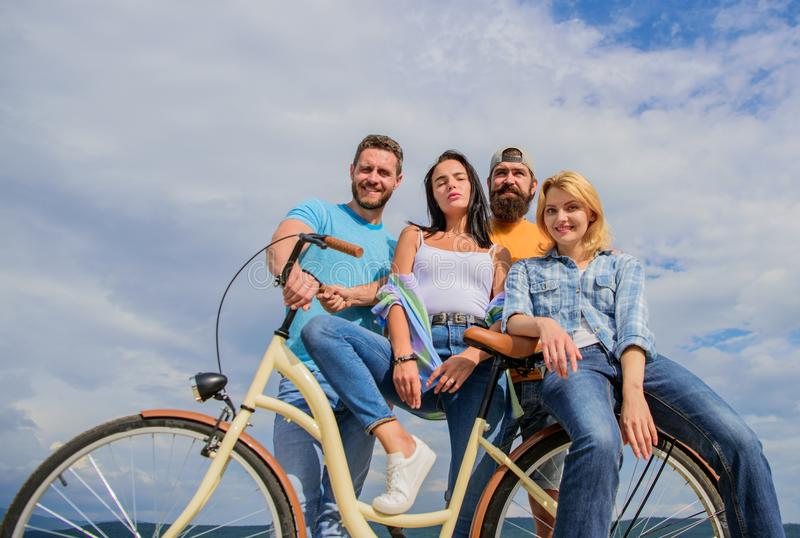 Group friends hang out with bicycle. Bicycle as best friend. Youth likes cruiser bike. Cycling modernity and national. Culture. Company stylish young people stock photos