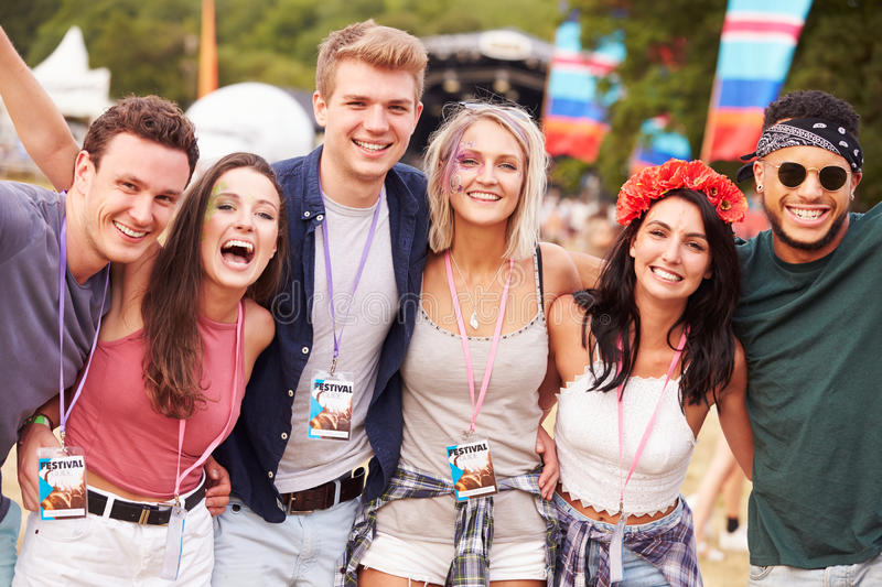 Group of friends hanging out together at a music festival royalty free stock photos