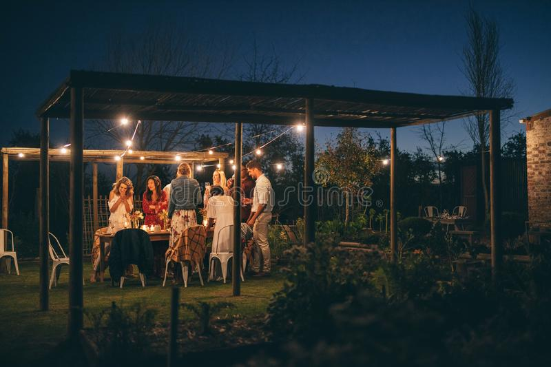 Group of friends having dinner party outdoors royalty free stock photos