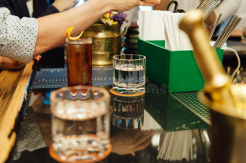 Group of friends having drinks whiskey at the night club after work . stock images