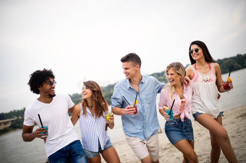 Group of friends having fun on the beach. Summer holidays, vacation and people concept. stock images