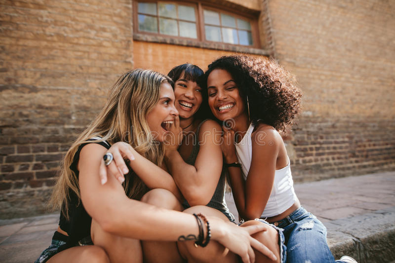 Group of friends having fun in the city royalty free stock photo