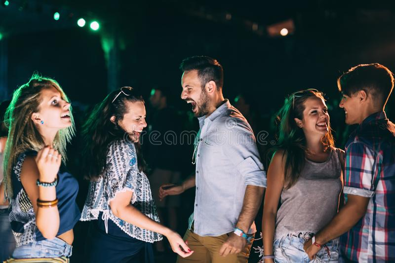 Group of friends having fun and dancing at concert. Group of friends having fun and dancing at festival concert stock photography