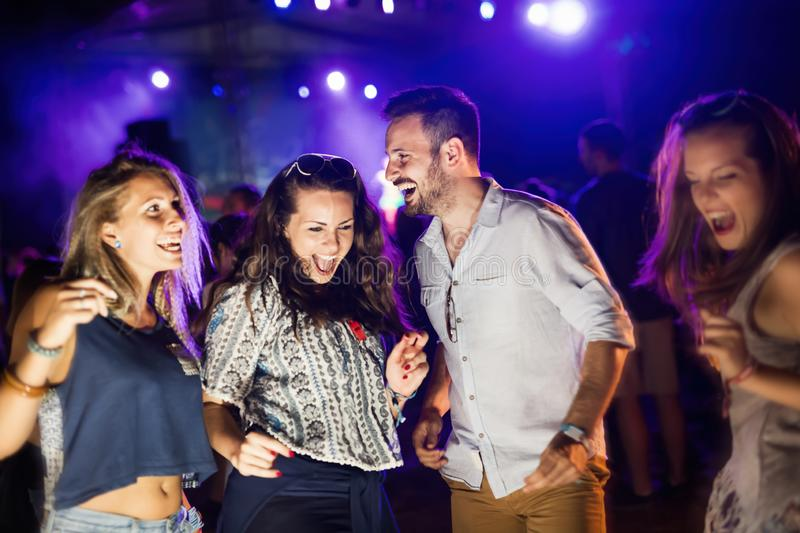 Group of friends having fun and dancing at concert. Group of friends having fun and dancing at festival concert stock images