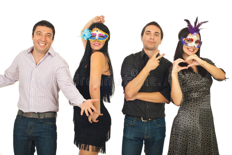 Group of friends having fun at party. Group of four friends having fun at party and posing in different styles isolated on white background stock image