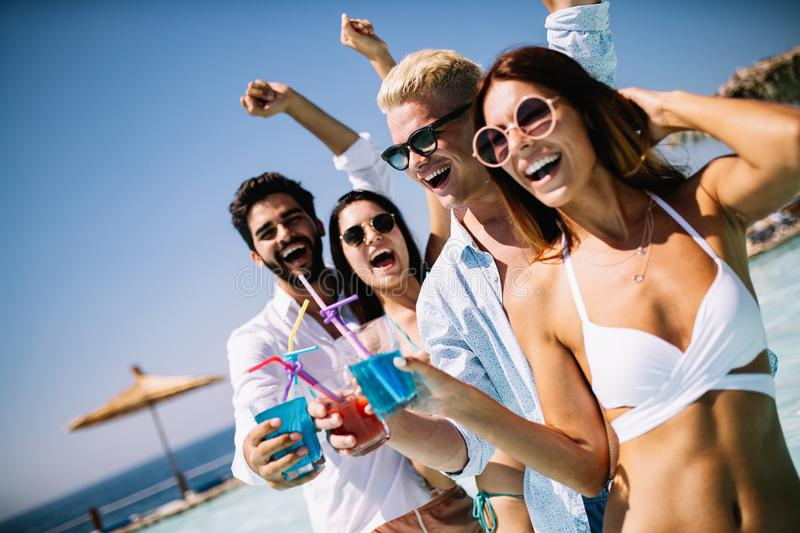 Group of friends having fun on summer vacation. Lifestyle, friendship, travel and holidays concept. Group of friends having fun on summer vacation and drinking royalty free stock image