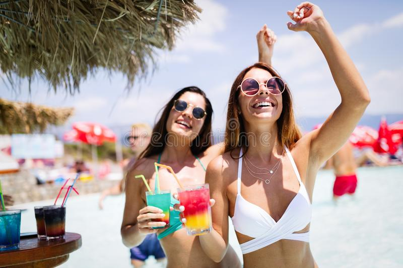 Group of friends having fun on summer vacation. Lifestyle, friendship, travel and holidays concept. Group of friends having fun on summer vacation and drinking stock image