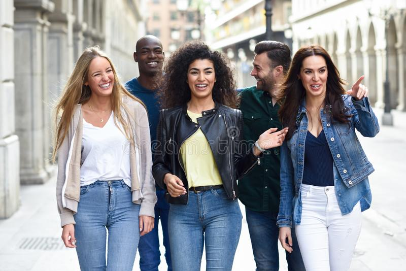 Group of friends having fun together outdoors royalty free stock images