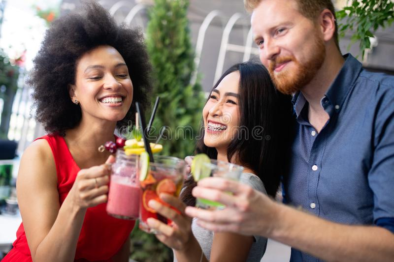 Group of friends having fun together. People talking laughing and enjoying their time stock photos