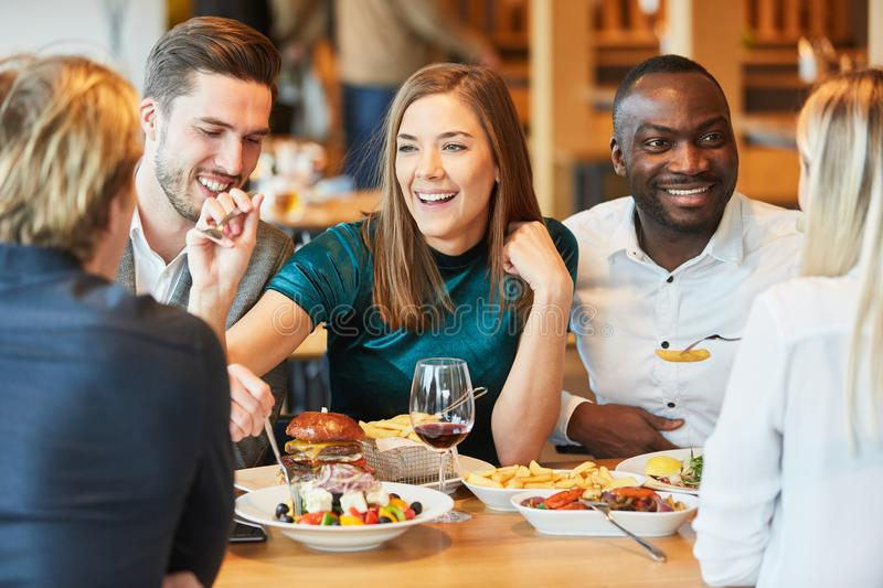 Group of friends having lunch in the restaurant royalty free stock photo